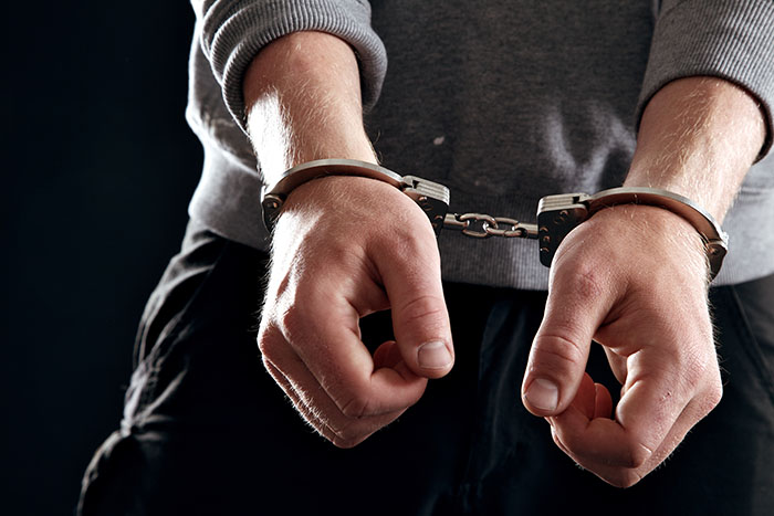 man-arrested-in-handcuffs